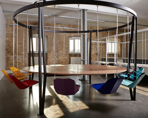 Whimsical Swing Table made to enjoy your days at the office