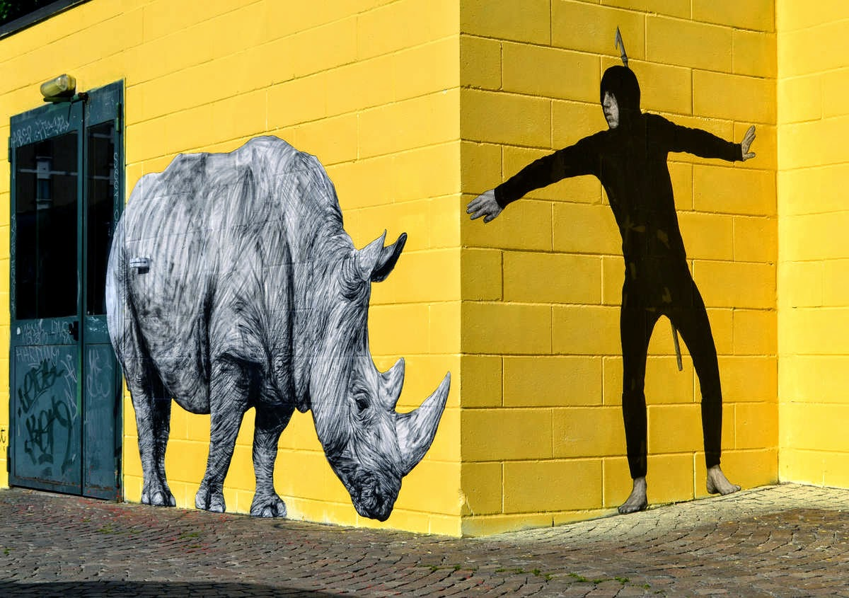 Levalet paints The Hunt in Bologna, Italy - the vandallist (1)