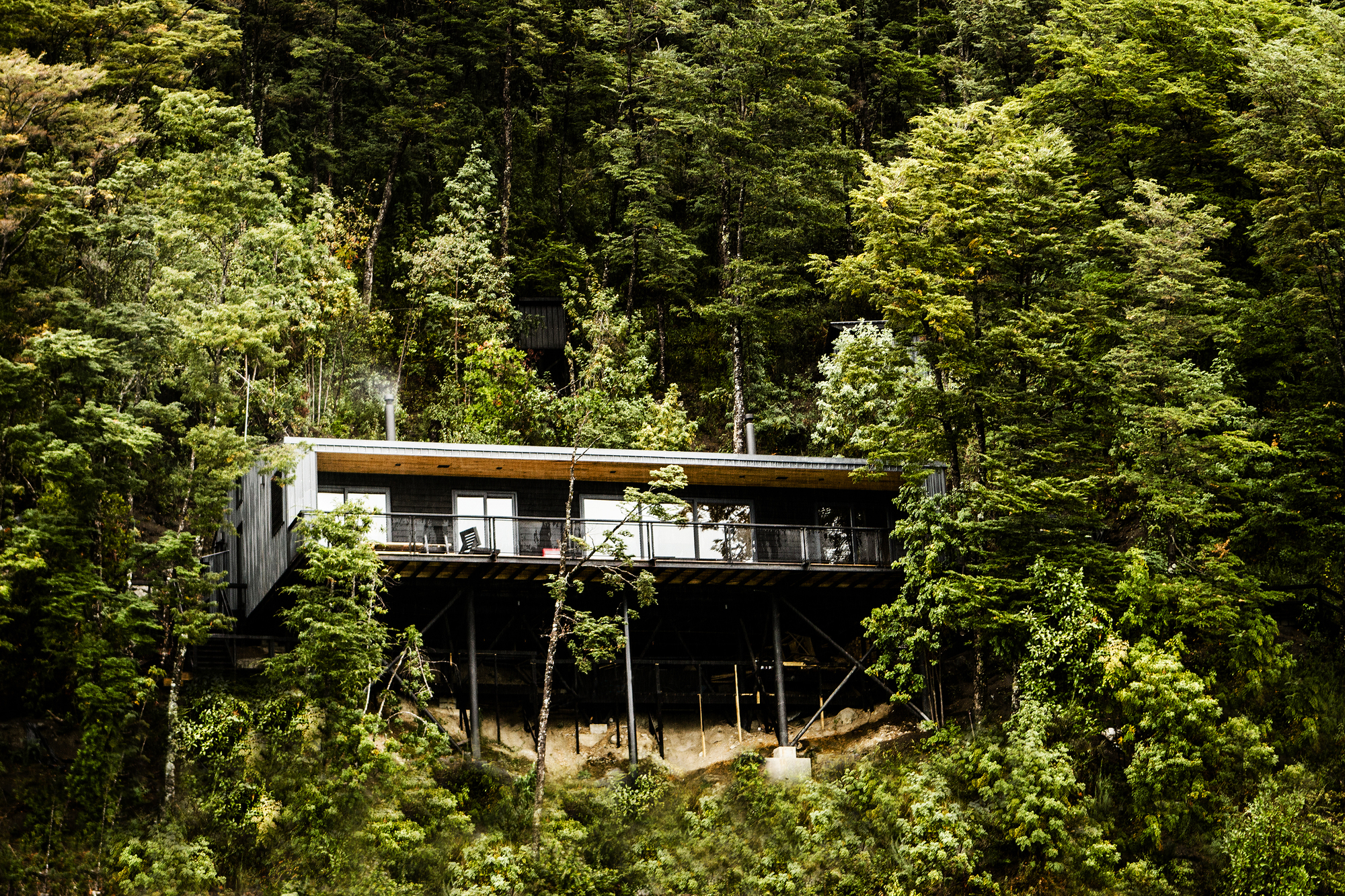 Hidden in the woods of todos los santos lake the vandallist for Acheter une maison en bois