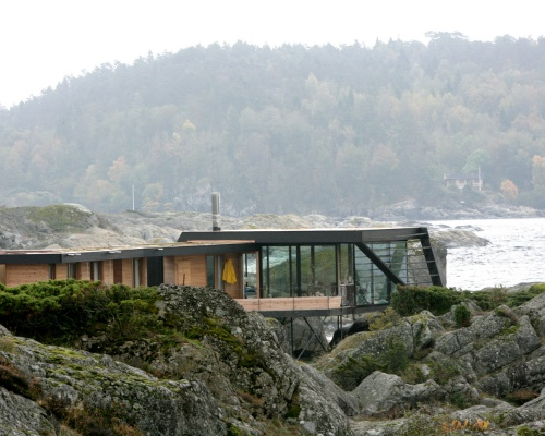 House perched on the rocks in Norway
