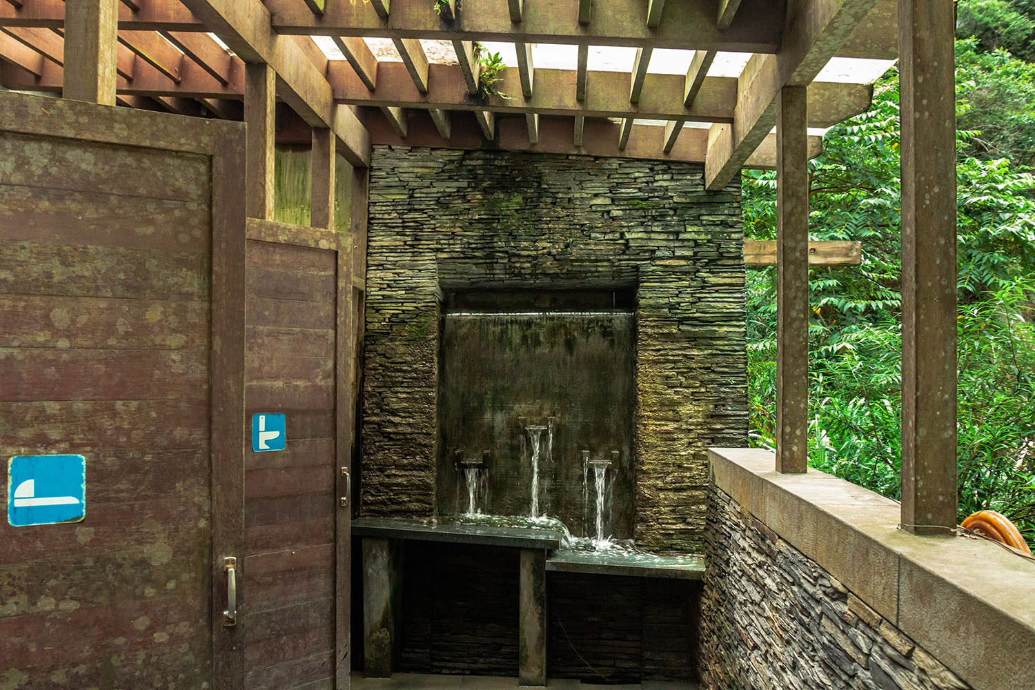 500px Photo ID: 117506037 - A washroom which taps it's water from the nearby waterfall. This is on the Baiyang Trail in Taroko National Park. Because this is a (mild) Hiking trail you don't expect to find such a strange luxury on the way.