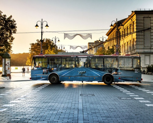 Street artist makes trolleybus disappear in Vilnius, Lithuania