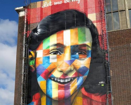 Anna Frank kaleidoscope-like mural – by EDUARDO KOBRA