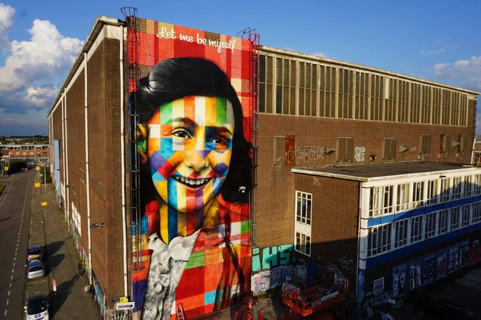 Anna Frank kaleidoscope-like mural - by EDUARDO KOBRA