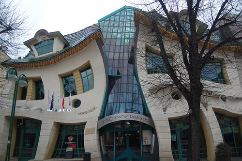 The crooked house - this is a real house located in Rezydent Shopping Center in Sopot, Poland. It is claimed to be the most photographed building in Poland. It is spread to an area of 4,000 square meters. Designed by Architect: Szotynscy Zaleski