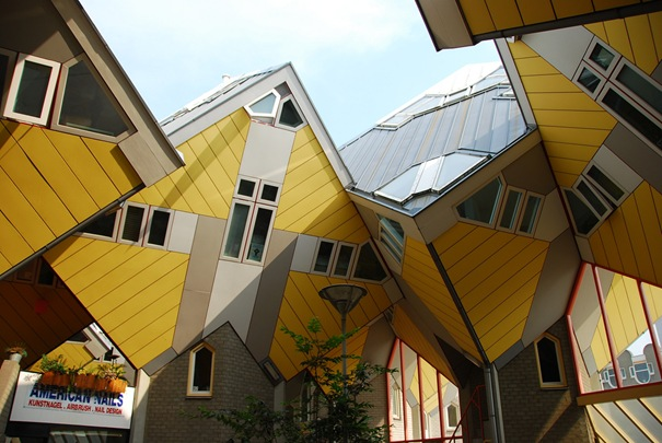 Cubic Houses (Rotterdam, Netherlands) - This is a housing designed on top of a pedestrian bridge. The main idea behind this is to create a forest of cubes (abstract trees) as each cube represents an abstract tree. The cubes are tilted and sit on hexagon-shaped pole structures. The cubes contain the living areas, which are split into three levels. The triangle-shaped lower level contains the living area.